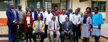 The Principal , His two Deputies, Ag. Deputy Registrar (Hr & Admin) pose for a group photo with the newly appointed Academic Staffs during Induction Meeting